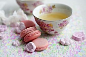 Green teas with macaroons and sugar flower rakugan (Japanese sweets)