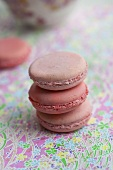 A stack of three rose and strawberry flavoured macaroons