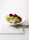 Calamari alla griglia (grilled calamari on a bed of salad)
