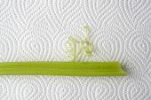 A stick of celery on kitchen paper