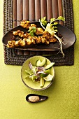 Chicken kebabs with salad and peanut sauce (Indonesia)