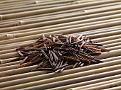 Wild rice on bamboo sticks