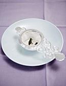 Tea strainer on a saucer