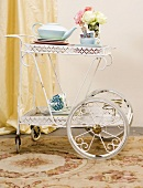 Place settings for tea on a tea trolley