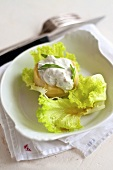 Artichoke hearts with cream cheese on lettuce leaves