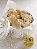 Springerle (embossed German Christmas biscuits) in a biscuit tin