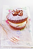 Chocolate and vanilla cupcake with icing sugar