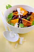 Pumpkin and bean curry with coconut chips