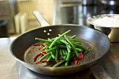 Green beans and pepper in the hotel kitchen Chateau Mcely (Czech Republic)
