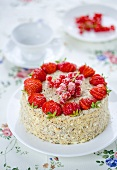 A strawberry and redcurrant cake