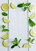 An arrangement of limes and mint leaves