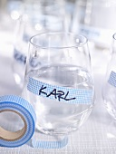 A name tag on a drinking glass