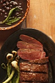 Fred beef steak with spring onions and bean soup