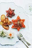 Sternförmiges Fischtartar mit Lachs, Thunfisch und Steinbutt (weihnachtlich)