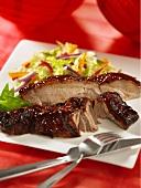 Pork ribs with a honey glaze and a side salad