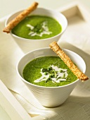 Pea soup with cream and breadsticks
