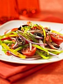 A colourful pepper salad with olives and tomatoes