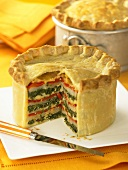 A layered vegetable pie, sliced
