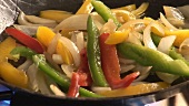 Sautéing vegetables in a frying pan