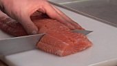 Slicing salmon fillet