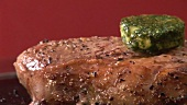 Peppered steak with melting herb butter