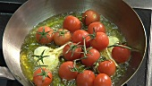 Frying tomatoes and garlic in oil