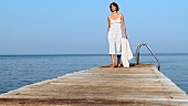 Young woman walking along a landing stage