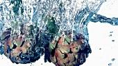 Artichokes falling into water