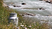 Milk churn beside a mountain stream