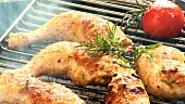 Chicken legs with rosemary on a barbecue