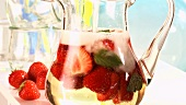 Adding sparkling wine to strawberry punch
