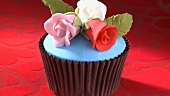 A cupcake with marzipan roses
