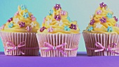 Cupcakes with yellow icing and sugar flowers