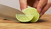 Cutting a lime into eighths