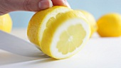 Cutting a slice of lemon
