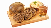 Haggis (stuffed sheep's stomach) with mashed potato & swede & whisky