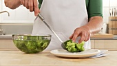 Blanching broccoli: removing the vegetables from the iced water