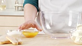 Preparing tiramisu: placing the egg yolks in a bowl