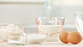 Baking ingredients: eggs, salt, sugar, flour, milk