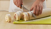 Strawberry cream swiss roll being prepared (German Voice Over)