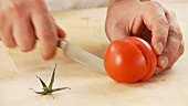 A tomato being quartered