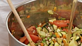 Vegetable stew being quenched with stock