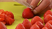 Fresh strawberries being chopped