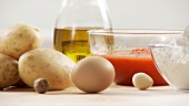 Ingredients for gnocci with tomato sauce: potatoes, egg, flour, tomato sauce, olive oil