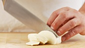 Buffalo mozzarella being sliced