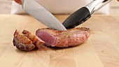 Slicing fried duck breast