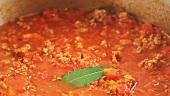 Bolognese sauce simmering