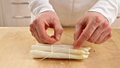 White asparagus being tied together