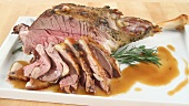 Roasted leg of lamb in slices and on the bone