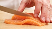 Salmon fillet being sliced